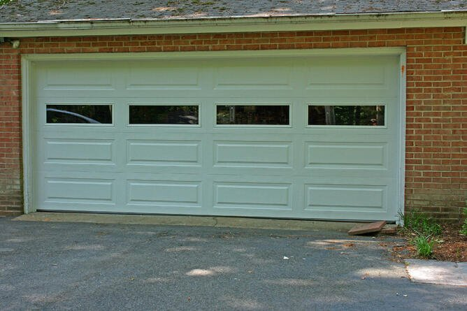 A New Garage Door enhances your home